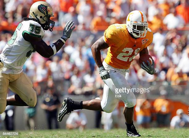 Gerald Riggs Jr. #21 of Tennessee carries the ball as Marcus Mark of UAB defends in the second half on September 3, 2005 at Neyland Stadium in...