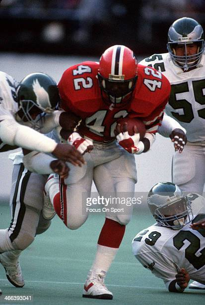 Gerald Riggs of the Atlanta Falcons carries the ball against the Philadelphia Eagles during an NFL football game November 10 1985 at Veterans Stadium...