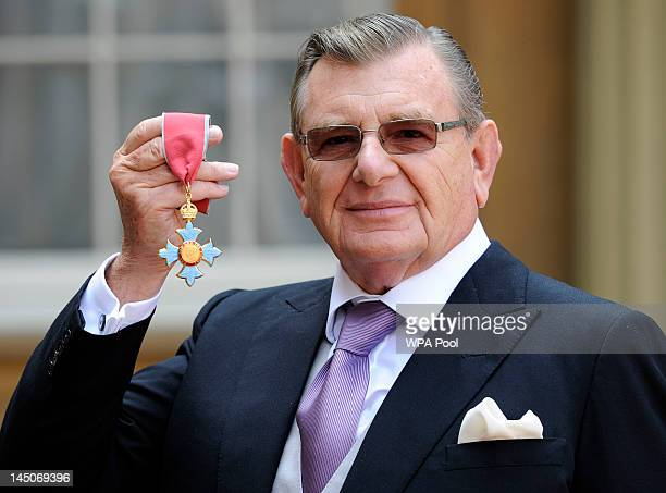 Gerald Ronson with his Commander of the British Empire following an Investiture ceremony hosted by the Princess Royal at Buckingham Palace on May 23...