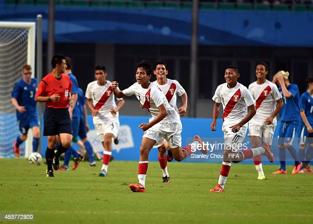 Gerald Tavara of Peru celebrates in style after scoring against Iceland during the 2014 FIFA Boys Summer Youth Olympic Football Tournament...