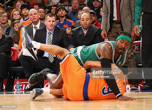 Gerald Wallace of the Boston Celtics gets wrapped up with Pablo Prigioni of the New York Knicks at Madison Square Garden on December 8 2013 in New...