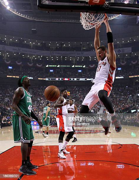 Gerald Wallace of the Boston Celtics looks on as Jonas Valanciunas of the Toronto Raptors dunks the ball during their NBA game at the Air Canada...