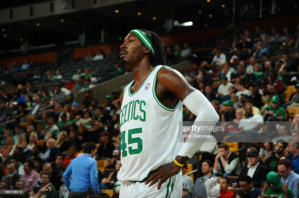 Gerald Wallace #45 of the Boston Celtics stands on the court against the Toronto Raptors on October 7, 2013 at the TD Garden in Boston, Massachusetts.