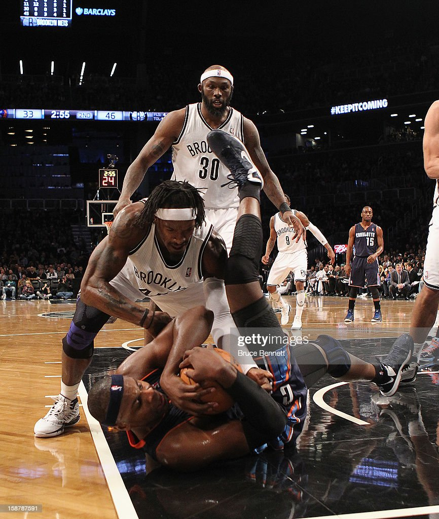 Gerald Wallace #45 of the Brooklyn Nets and Brendan Haywood #33 of the Charlotte Bobcats wrestle for the ball during the second quarter at the Barclays Center on December 28, 2012 in the Brooklyn borough of New York City.