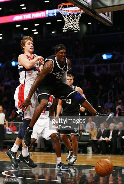Gerald Wallace of the Brooklyn Nets battles for a rebound against Jan Vesely of the Washington Wizards during a preseason game at the Barclays Center...