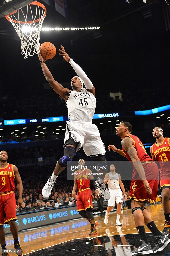 Gerald Wallace #45 of the Brooklyn Nets goes to the basket against Alonzo Gee #33 of the Cleveland Cavaliers at the Barclays Center on December 29, 2012 in Brooklyn, New York.