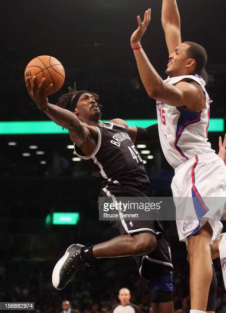 Gerald Wallace of the Brooklyn Nets scores two past Ryan Hollins of the Los Angeles Clippers in the fourth quarter at the Barclays Center on November...