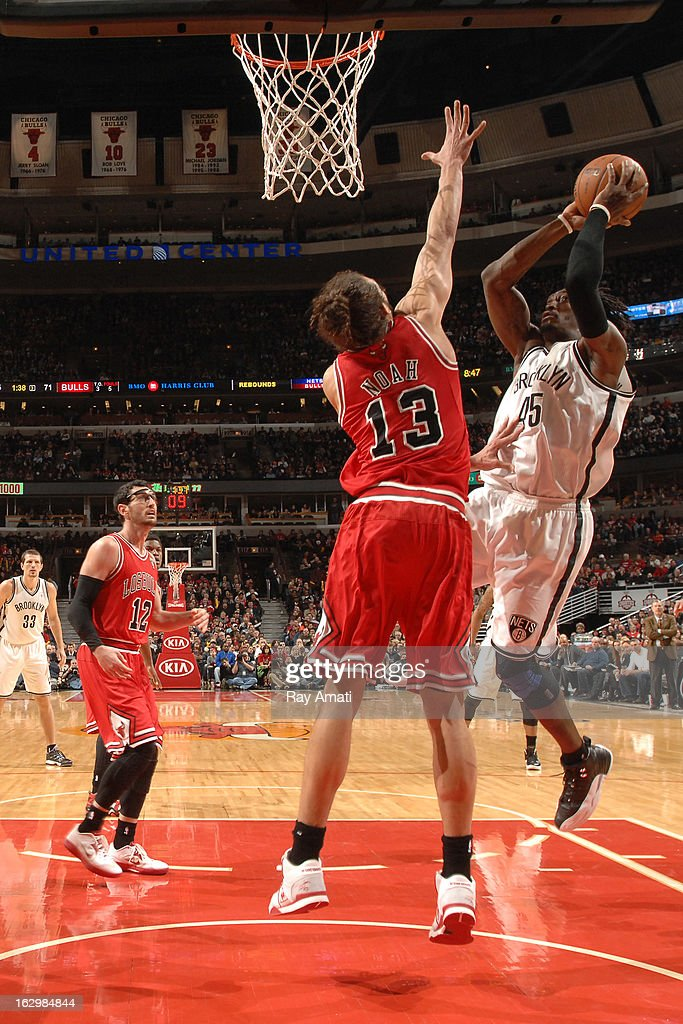 Gerald Wallace #45 of the Brooklyn Nets shoots against Joakim Noah #13 of the Chicago Bulls on March 2, 2013 at the United Center in Chicago, Illinois.