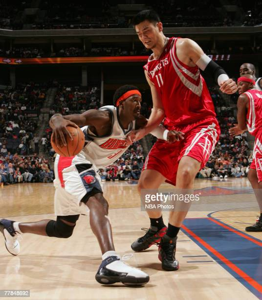 Gerald Wallace of the Charlotte Bobcats drives to the basket against Yao Ming of the Houston Rockets on November 11 2007 at the Charlotte Bobcats...
