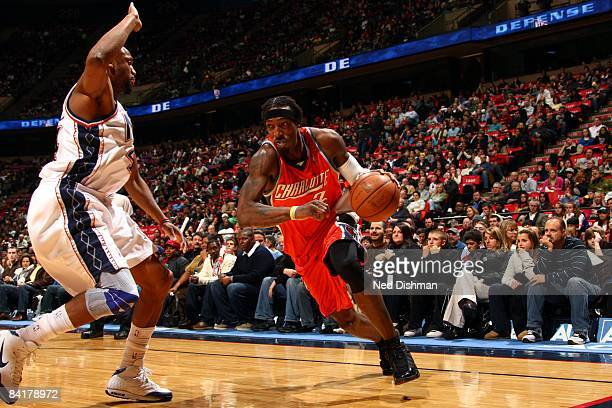 Gerald Wallace of the Charlotte Bobcats drives to the basket against Trenton Hassell of the New Jersey Nets during the game at the IZOD Center on...