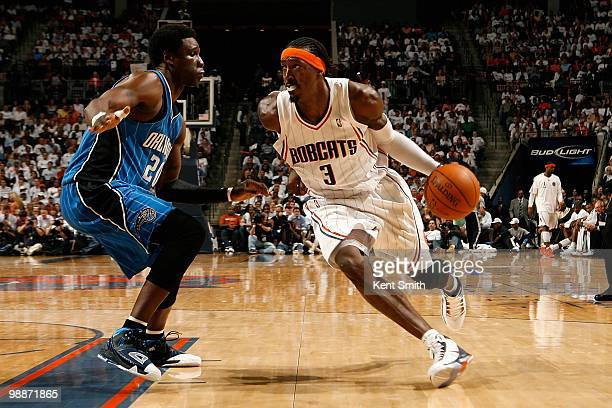Gerald Wallace of the Charlotte Bobcats drives to the basket past Mickael Pietrus of the Orlando Magic in Game Four of the Eastern Conference...