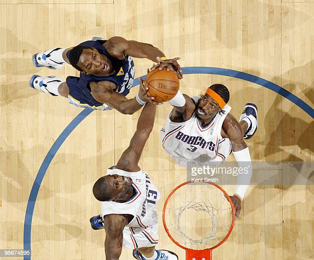 Gerald Wallace of the Charlotte Bobcats dunks against Hasheem Thabeet of the Memphis Grizzlies as Nazr Mohammed reaches in on January 9 2010 at the...