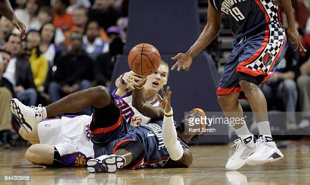 Gerald Wallace of the Charlotte Bobcats fights for the ball with Louis Amundson of the Phoenix Suns on January 23 2009 at the Time Warner Cable Arena...