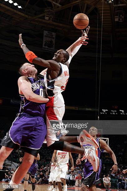Gerald Wallace of the Charlotte Bobcats gets denied the dunk by a block from Greg Ostertag of the Sacramento Kings on March 1 2005 at the Charlotte...