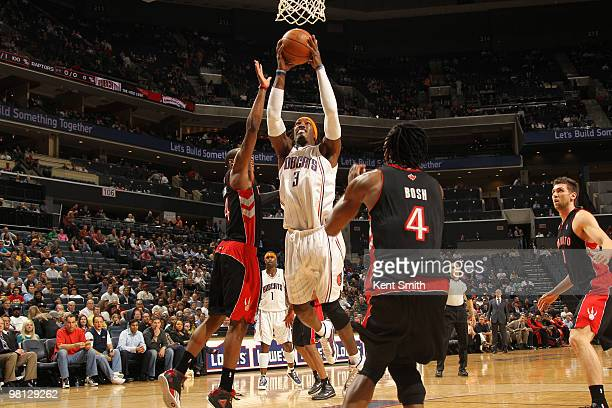 Gerald Wallace of the Charlotte Bobcats goes for the layup against Antoine Wright of the Toronto Raptors on March 29 2010 at the Time Warner Cable...