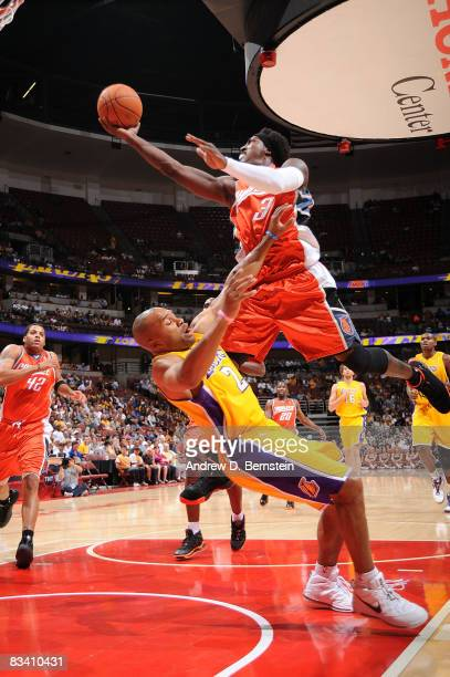 Gerald Wallace of the Charlotte Bobcats goes up for a shot against Derek Fisher of the Los Angeles Lakers on October 23 2008 at Honda Center in...