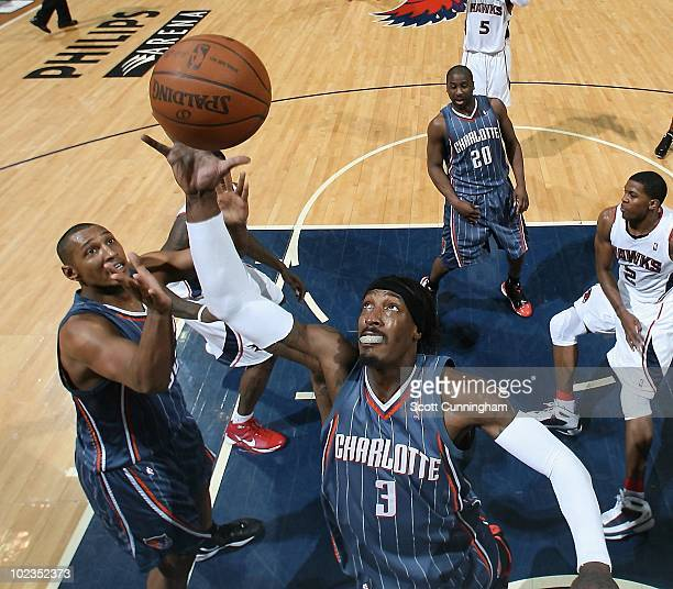 Gerald Wallace of the Charlotte Bobcats grabs a rebound against the Atlanta Hawks during the game on March 19 2010 at Philips Arena in Atlanta...