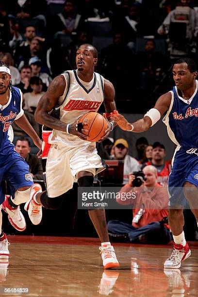 Gerald Wallace of the Charlotte Bobcats keeps the ball from the Los Angeles Clippers on December 23 2005 at the Charlotte Bobcats Arena in Charlotte...