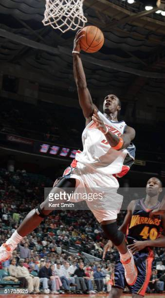 Gerald Wallace of the Charlotte Bobcats leaps to the basket against the Golden State Warriors during NBA action on November 13, 2004 at the Charlotte...