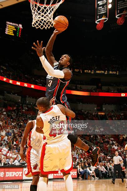 Gerald Wallace of the Charlotte Bobcats shoots against James Posey of the Miami Heat on April 8 2007 at American Airlines Arena in Miami Florida NOTE...