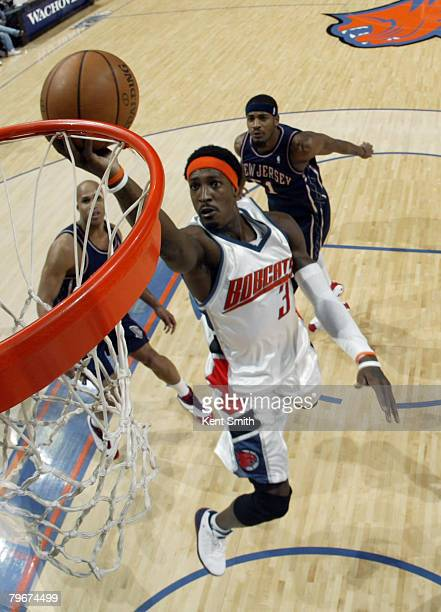 Gerald Wallace of the Charlotte Bobcats shoots against the New Jersey Nets on February 8 2008 at the Charlotte Bobcats Arena in Charlotte North...
