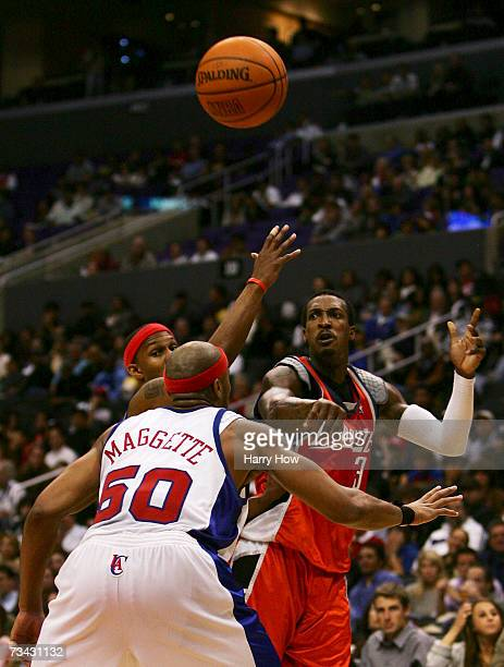 Gerald Wallace of the Charlotte Bobcats tries a pass around Daniel Ewing and Corey Maggette of the Los Angeles Clippers during the third quarter at...