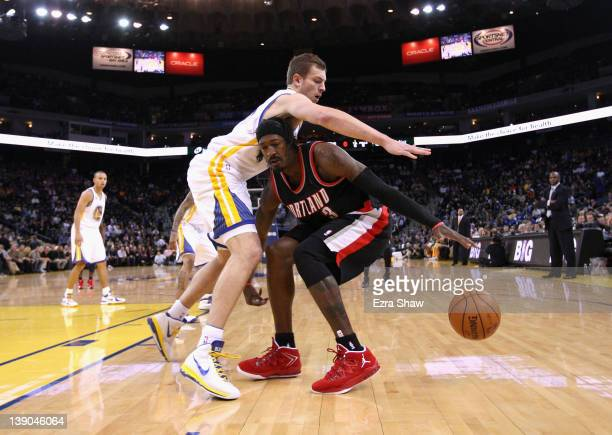 Gerald Wallace of the Portland Trail Blazers drives on David Lee of the Golden State Warriors at Oracle Arena on February 15 2012 in Oakland...
