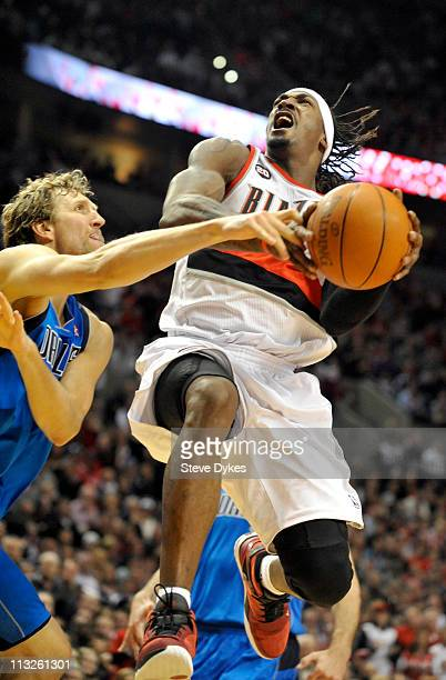 Gerald Wallace of the Portland Trail Blazers is fouled by Dirk Nowitzki of the Dallas Mavericks during the fourth quarter of Game Six of the Western...