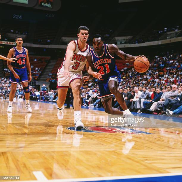 Gerald Wilkins of the Cleveland Cavaliers dribbles against the New Jersey Nets circa 1993 at the Contintental Airlines Arena in East Rutherford New...