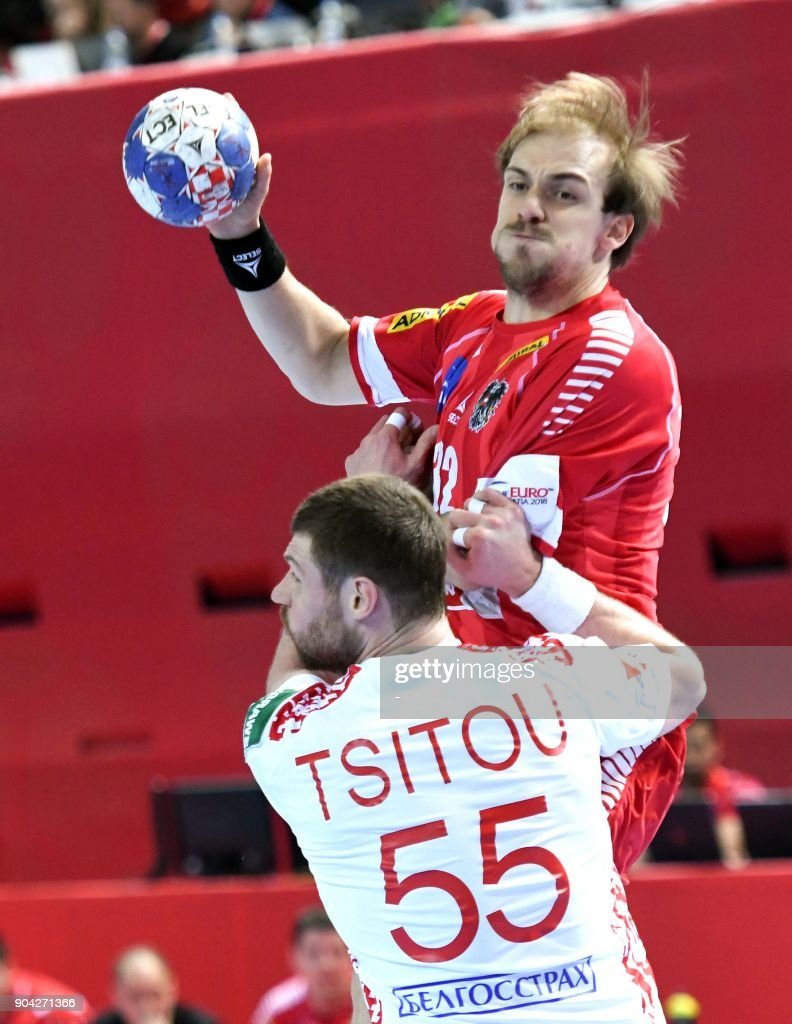 Gerald Zelner (R) of Austria vies for the ball with Aliaksandr Tsitou of Belarus during the preliminary round group B match of the Men's 2018 EHF European Handball Championship between Belarus and Austria in Porec, Croatia on January 12, 2018. /