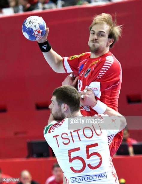 Gerald Zelner of Austria vies for the ball with Aliaksandr Tsitou of Belarus during the preliminary round group B match of the Men's 2018 EHF...