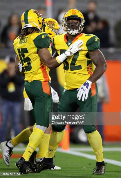 Gerald Christian of the Arizona Hotshots celebrates his touchdown with teammate Rashad Ross during the Alliance of American Football game against the...