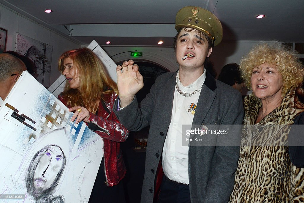 Geraldine Beigbeder (L) and Pete Doherty attend the 'Flags From The Old Regime' : Pete Doherty and Alize Meurisse Paintings Exhibition Preview At Espace Djam on November 21, 2013 in Paris, France. Pete Doherty;Geraldine Beigbeder