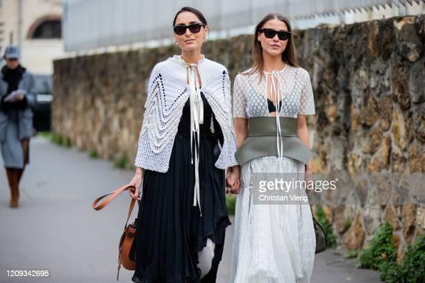 Geraldine Boublil and Sophia Roe wearing corset, sheer top, skirt is seen outside Loewe during Paris Fashion Week - Womenswear Fall/Winter 2020/2021...