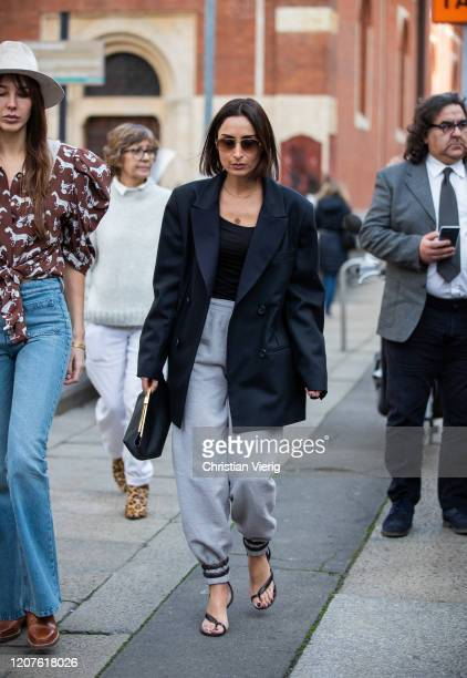 Geraldine Boublil is seen wearing black blazer, grey pants, Bottega sandals outside Pucci during Milan Fashion Week Fall/Winter 2020-2021 on February...