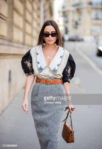 Geraldine Boublil is seen wearing grey skirt blouse brown bag outside Miu Miu during Paris Fashion Week Womenswear Fall/Winter 2020/2021 Day Nine on...