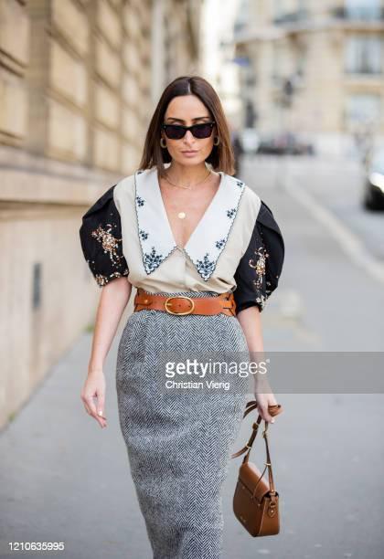Geraldine Boublil is seen wearing grey skirt, blouse, brown bag outside Miu Miu during Paris Fashion Week - Womenswear Fall/Winter 2020/2021 : Day...