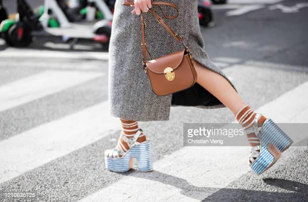 Geraldine Boublil is seen wearing grey skirt, brown bag, platform sandals outside Miu Miu during Paris Fashion Week - Womenswear Fall/Winter...