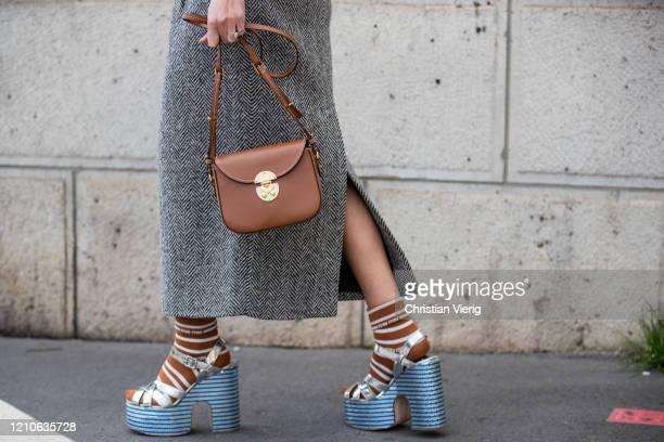 Geraldine Boublil is seen wearing grey skirt brown bag platform sandals outside Miu Miu during Paris Fashion Week Womenswear Fall/Winter 2020/2021...