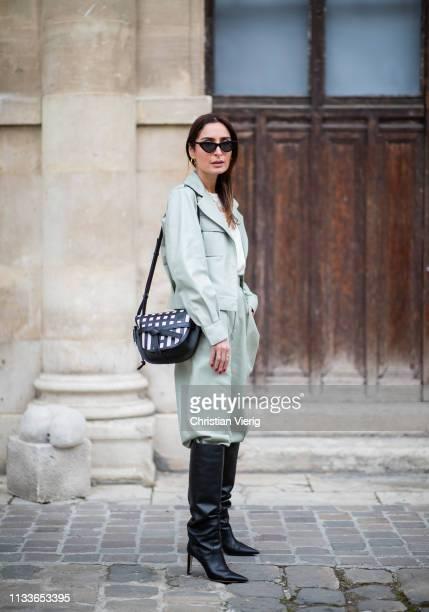 Geraldine Boublil is seen wearing mint pants, jacket Loewe bag, black boots outside Thom Browne during Paris Fashion Week Womenswear Fall/Winter...