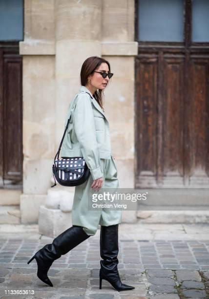 Geraldine Boublil is seen wearing mint pants jacket Loewe bag black boots outside Thom Browne during Paris Fashion Week Womenswear Fall/Winter...