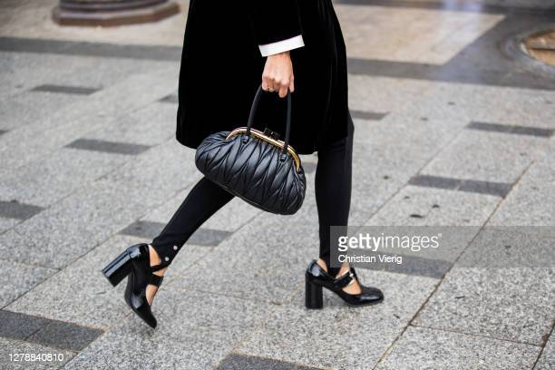 Geraldine Boublil seen wearing black coat, black bag, tights, heels outside Miu Miu lunch during Paris Fashion Week - Womenswear Spring Summer 2021 :...