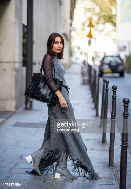 Geraldine Boublil seen wearing grey skirt and sleeveless jacket, belt, sheer top, black bag outside Paco Rabanne during Paris Fashion Week -...