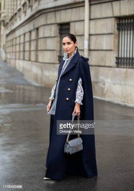 Geraldine Boublil seen wearing navy double breasted coat with slits blouse outside Miu Miu during Paris Fashion Week Womenswear Spring Summer 2020 on...