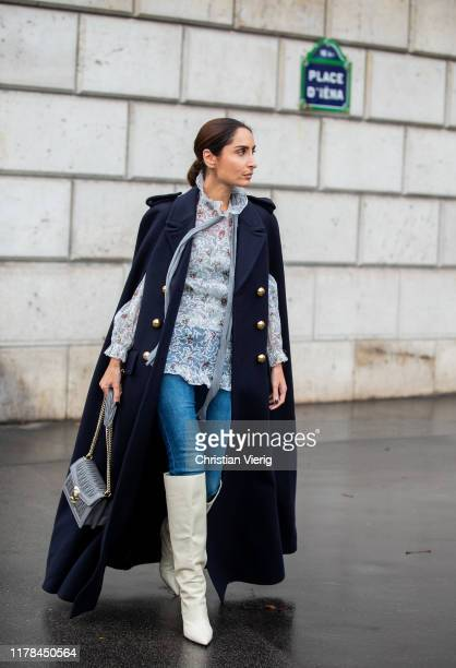 Geraldine Boublil seen wearing navy double breasted coat with slits, blouse outside Miu Miu during Paris Fashion Week Womenswear Spring Summer 2020...