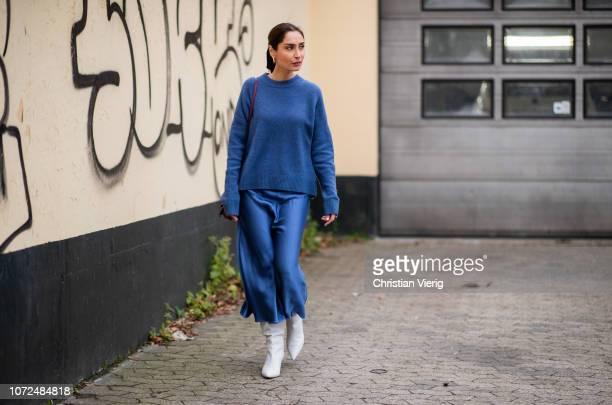 Geraldine Boublil wearing blue knit blue midi skirt white ankle boots Loewe bag is seen outside Samsoe Samsoe Autumn 2019 Resee on December 13 2018...