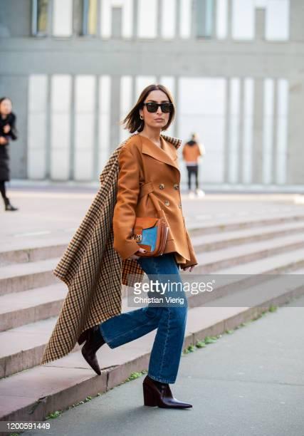 Geraldine Boublil wearing brown blazer, denim jeans, checkered coat on the back, bag seen outside Lanvin during Paris Fashion Week - Menswear F/W...