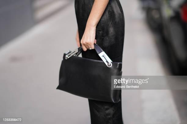 Geraldine Boublil wears a Loewe black rectangular large leather bag on June 29 2020 in Paris France