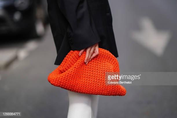 Geraldine Boublil wears a red woven leather Bottega Veneta bag an oversized blazer jacket on June 29 2020 in Paris France