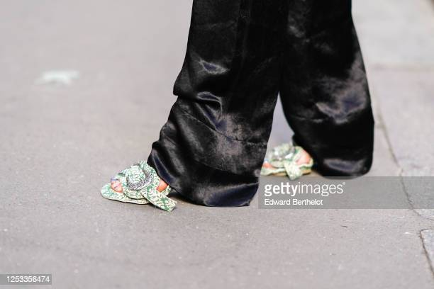 Geraldine Boublil wears flared pants from Acne Studios green floral print shoes from Acne Studios on June 29 2020 in Paris France